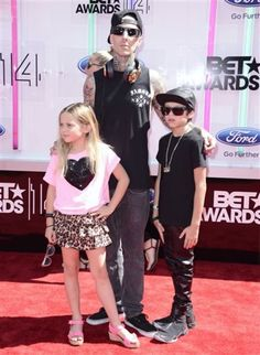 BET Awards 2014 - Travis Barker (center) with Alabama Barker (left), and Landon Barker (right) arrive at the BET Awards at the Nokia Theatre.