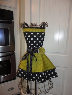 "4RetroSisters ""Annabelle Style""  Enchanged Garden - Womens Retro Apron. $37.50, via Etsy."