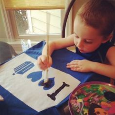 DIY stencil for Dr. Who shirt. It's just better that it's a little boy making this.