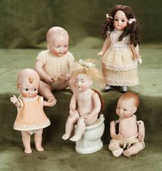 I would be shipping right back!   -Box of Five Wonderful and Rare German All Bisque Dolls 300/400
