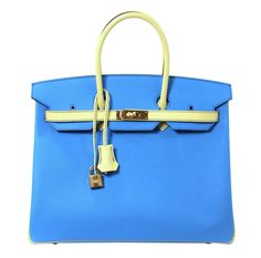 Hermès Blue Paradis  Jaune Canari Epsom BiColor Birkin 35 - Hermès 35 cm Horseshoe Birkin Bag in BLEU PARADIS and JAUNE CANARI Epsom Leather - Never Carried, Pristine with the protective plastic intact on the hardware. Hand stitched by skilled craftsmen with extensive wait lists, the Hermès Birkin is long considered the ultimate in luxury fashion.  A horseshoe Birkin (see stamp) or specially ordered Birkin is considered extremely rare and collectible; they are only offered to select…