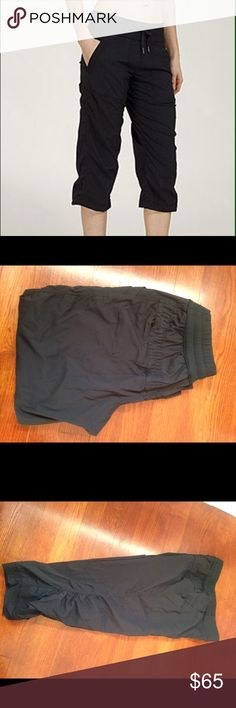 Black Lulu Studio Crops So cute and comfy!  Love the gathering on the legs, cute back zipper pocket and front seam pockets as well!  I removed the tag and cannot find a size circle in these, but I wear a 4 and I bought these, so I'm sure they're a 4!! . Only wore/washed these a few times. Great condition! lululemon athletica Pants Capris