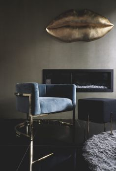 Electric fireplace and a glam chair.