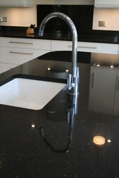 Single undermount sink is positioned on the kitchen island.