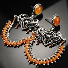 https://www.facebook.com/bartoszciba.jewelry/photos/pb.335313556612627.-2207520000.1415141406./556898314454149/?type=3