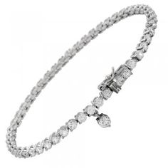 Silver Diamonfire Synthetic Clear Tennis Bracelet. Diamonfire have created a desirable and beautiful collection of jewellery in silver, containing sparkling cubic zirconia stones in various faceted cuts and sizes. This tennis bracelet has a run of clear cubic zirconia stones set side by side in silver, fitted with a fig 8 safety catch. Model Ref:64/0334/1/006. #MyFavouriteJewelleryAtBurnsJewellers