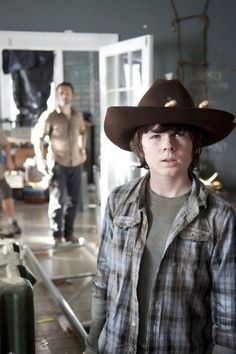 Chandler Riggs (Carl) and Andrew Lincoln (Rick) spoiler from The Walking Dead Season 4.
