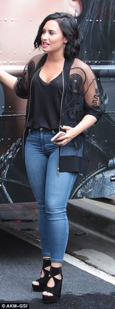 Looking good! Lovato sported tight blue jeans and sexy heels, while Joe kept it casual in ...