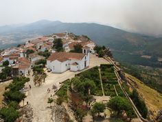 Village of Marvão, Alentejo region, Portalegre district, Portugal is situated atop a rocky mount at 860m of altitude.  The village was established by the Arab Ibn Maruan (IX century). | Photo by Krzysztof Żwirski CC BY 2.5 on Wikipedia at: https://en.m.wikipedia.org/wiki/Marvão#/media/File%3AMarvão_27.jpg | Pinned by Charlotte