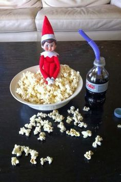 Popcorn night - Mmm mm mm!  Yesterday, he was hanging inside your toilet - eat up!