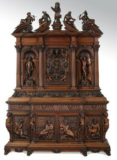 Exceptional 19th c. Italian carved figural cabinet.