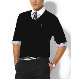 This gentle man's attire is perfect for a future educator. He is wearing nice slacks with a rolled-up long sleeve underneath with a tie. And over all that a nice sweater. Very professional.
