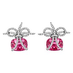 """""""Wrapped"""" rubellite and diamond earrings in platinum. Two cushion-cut rubellites weighing approximately 19.63 total carats (each approximately 12mm x 15mm) and round-cut diamonds weighing 1.55 total carats. With clip backs and posts. Designed by Verdura. 25mm length from top of diamond-set 'ribbon' to base of rubellite."""