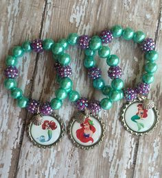 This listing is for a set of 6 Ariel inspired party favor bracelets. Perfect for your Ariel party each packaged individually ready to hand out to your guests :) please message me so any questions or custom requests and check out my other mermaid/Ariel party favors in my shop :)