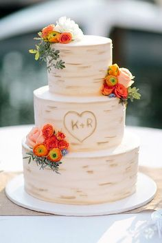 30 Small Rustic Wedding Cakes On A Budget ❤ small rustic wedding cakes the birch bark with the initials in the heart is decorated with bright flowers troy grover ❤ See more: http://www.weddingforward.com/small-rustic-wedding-cakes/ #wedding #bride