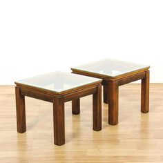 This pair of square end tables are featured in a solid wood with a glossy walnut finish. These contemporary side tables have square frames, glass table tops and carved straight legs. Sleek and modern tables perfect for the side of a sofa! #americantraditional #tables #endtable #sandiegovintage #vintagefurniture