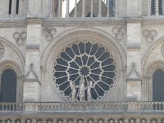 Paris, France - Notre-Dame the church was begun in 1163, the towers were added in 1245, finished in 1345. The center rose window dates back to 1220, 33 feet in diameter.