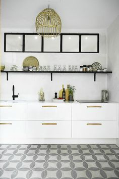 white and grey kitchen in a relaxed Danish oasis in Palma, Mallorca. Tine K Home.
