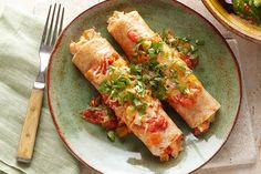 Loaded with cheeses, seasonings and veggies, these chicken enchiladas are a delectable take on Tex-Mex.