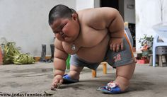 This Is Very Very Amazing Picture Of World's Most Fat Baby. In This Funny Picture You Can See That A Fattest Kid Of The World Is Picking Something On Floor. This Fat Baby Has An Amazing Body Which Looks Like A Sumo Wrestler.
