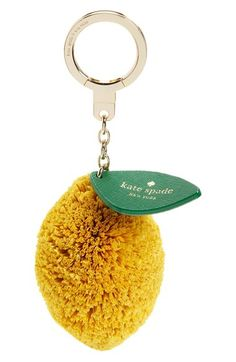 When life gives you lemons, use one done up as a fun and colorful bag charm in raffia and leather to brighten your favorite handbag.