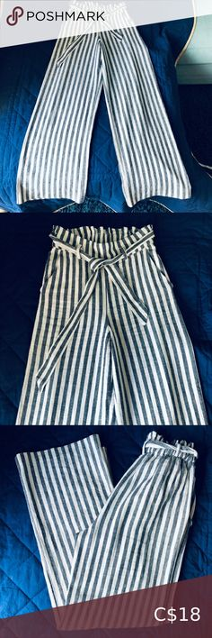 """Dynamite Grey & White Striped Wide Leg Pants Wide Leg, Paper Bag style pants with elastic waist in back and belt tie. 55% Linen, 45% Rayon. 30.5"""" inseam, 12"""" rise from crotch to top Great condition, worn twice Dynamite Pants & Jumpsuits Wide Leg Wide Leg Linen Pants, Flowy Pants, Yellow Blouse, Striped Linen, Full Zip Hoodie, Black Sequins, Grey Hoodie, Grey And White, Elastic Waist"""