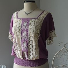 Lilac Crochet Boho Peasant Sassy Elegant Blouse Wow! From the detail to the color. Exquisite. Made of Rayon. Crochet is see through. A tank will need to be worn under. Elastic waist. Plain back. Boutique Tops Blouses