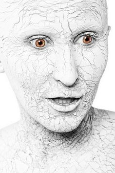 halloween makeup for women, white cracked skin could be a mummy or supernatural effect