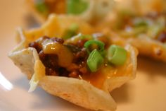 Everyone always loves these individual nachos.  You can make the meat mixture up ahead of time and store in the fridge in tupperware until ready to use.  The meat mixture freezes well too.  If you are short on spices, just use a taco packet instead.  I often use leftover taco meat that I need to use up.