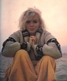 "Marilyn Monroe On Santa Monica Beach 1962      Marilyn Monroe photographed by George Barris    ""I could see a sadness in her eyes;   she had learned to smile, laugh and clown, even though her heart was breaking""  ~ George Barris, on their photos at the beach."
