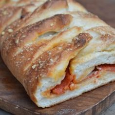 Frozen bread dough makes this tasty recipe a breeze to prepare! Pepperoni, mozzarella cheese and Italian seasonings are rolled together, baked to delicious perfection, then cut into bite-sized delights. Your guests will beg for the recipe!