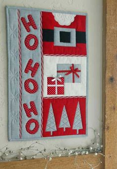 Ho Ho Holiday Blog Hop: Love this quilt with just a bit of Santa showing.