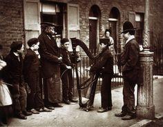 Street musicians in London, 1870s.