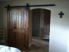 Barn door made of cypress, handles are cast iron from a salvage yard. To the office?