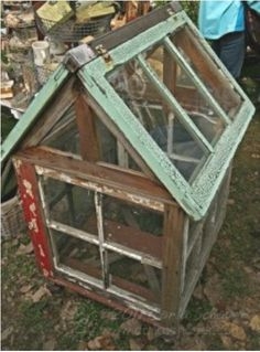 Old window greenhouse! There's someone I know who has a few old windows in her backyard.I wonder what she plans to do with them? This is definitely an idea! houses old windows 5 Trends Spotted at the Country Living Fair Old Window Greenhouse, Small Greenhouse, Greenhouse Plans, Greenhouse Wedding, Indoor Greenhouse, Homemade Greenhouse, Portable Greenhouse, Pallet Greenhouse, Greenhouse Gardening
