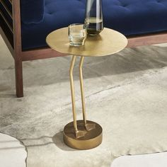Shop Brass Bird Side Table.   The playful, modern silhouette of this Fred Segal side table feels plucked from a Hollywood Hills patio.  Minimalist bird legs lead from a rounded base to a flat surface ready to serve cocktails and snacks.