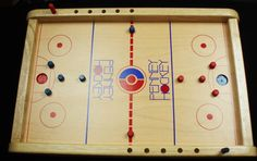 Penny Hockey - Unique fun for all ages. Flick the penny to score a Gooaaal! Penny Game, Board Game Template, Door Games, Wooden Board Games, Easy Shots, Class Projects, Wood Projects, Family Game Night, Tabletop Games