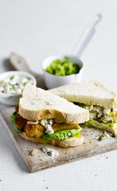 For a classic and delicious lunchtime dish, try our fish finger sandwich recipe with homemade tartare sauce, pea puree and pickled onions. Find the recipe on the Waitrose website. Salmon Recipes, Fish Recipes, Seafood Recipes, Cooking Recipes, Spicy Recipes, Appetizer Sandwiches, Finger Sandwiches, Gluten Free Menu, Gluten Free Recipes