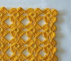 CrochetClub.com shares this brilliant Russian tutorial (easily translatable, plus easy-to-follow pics) for this awesome little stitch.  On my to-do list!