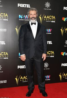 Red carpet regular: Hollywood director and actor Mel Gibson, 60, cut a suave figure in a t...