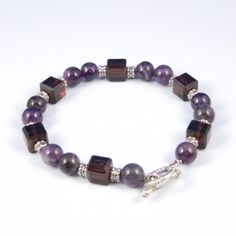 Square Echo Bracelets with multi-colored Sapphires.