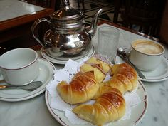 Argentine Medialunas  Traditional Argentine breakfast of cafe con leche (coffee with milk) and medialunas (half-shaped moon croissants).