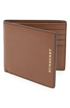 Free shipping and returns on Burberry Grainy Leather Folding Wallet at Nordstrom.com. Embossed goldtone logo letters brand a grained calfskin wallet outfitted with space inside for all the essentials.