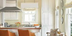 Warm-toned kitchen, Kravet vinyl-covered Lee barstools, antique bench. *wall color