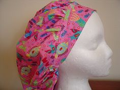 10.99 This is another fun scrub hat. It is done in a great pink with fun brightly colored tropical fish swimming all over it. The fish are...