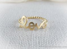 gold love ring with twisted ringband us size 5 - 8. $13.00, via Etsy.