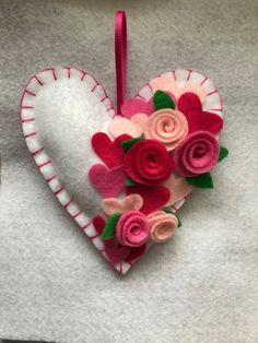 A personal favorite from my Etsy shop https://www.etsy.com/listing/577720384/valentines-felt-heart-ornament