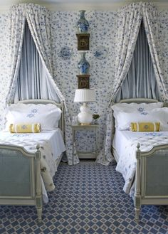Cottage ♥ Guest bedroom with floral print canopies ~ LOVE the matching wallpaper!