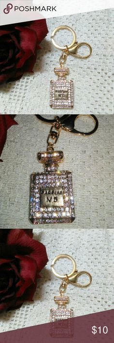 b51c02ee4980 Chanel key fob New !This is a really high quality, nice looking keychain/ purse  charm. Blingged out Chanel goldtone perfume bottle.