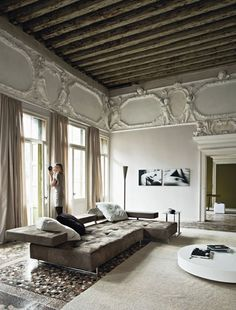 Stunning contrasts of modern furniture with antique architectural backdrop